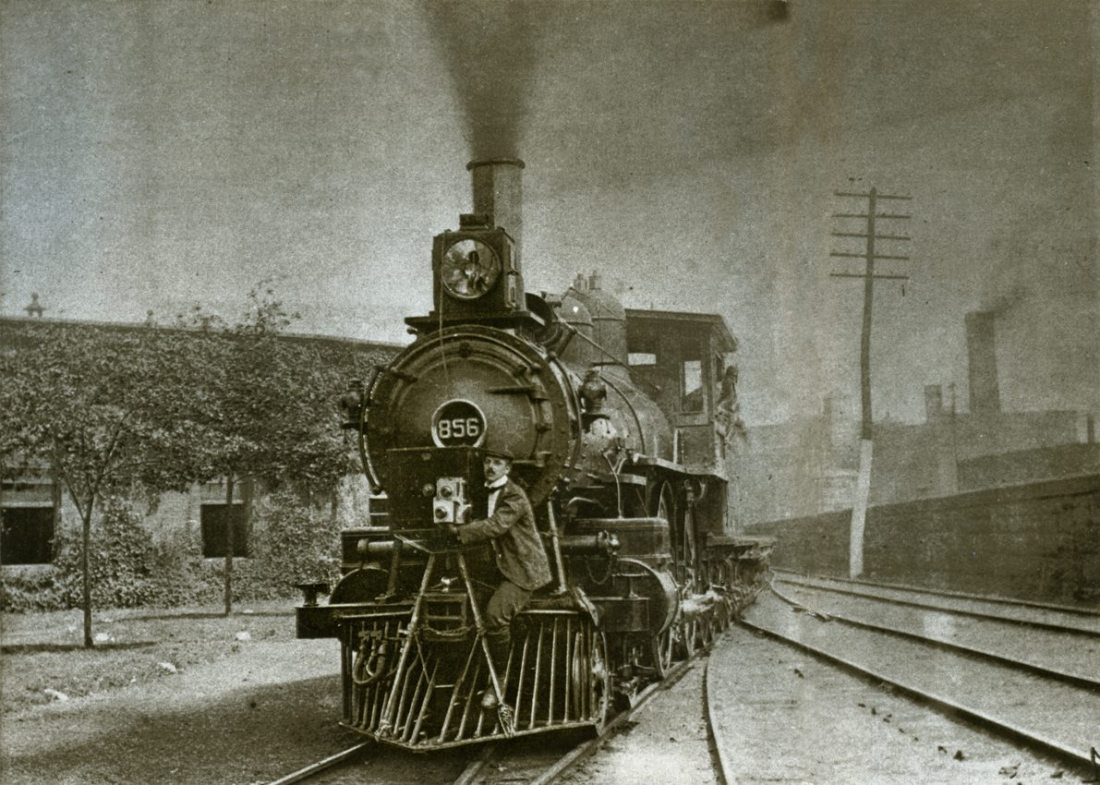 Billy Bitzer strapped to the front of a train filming a 'phantom ride'